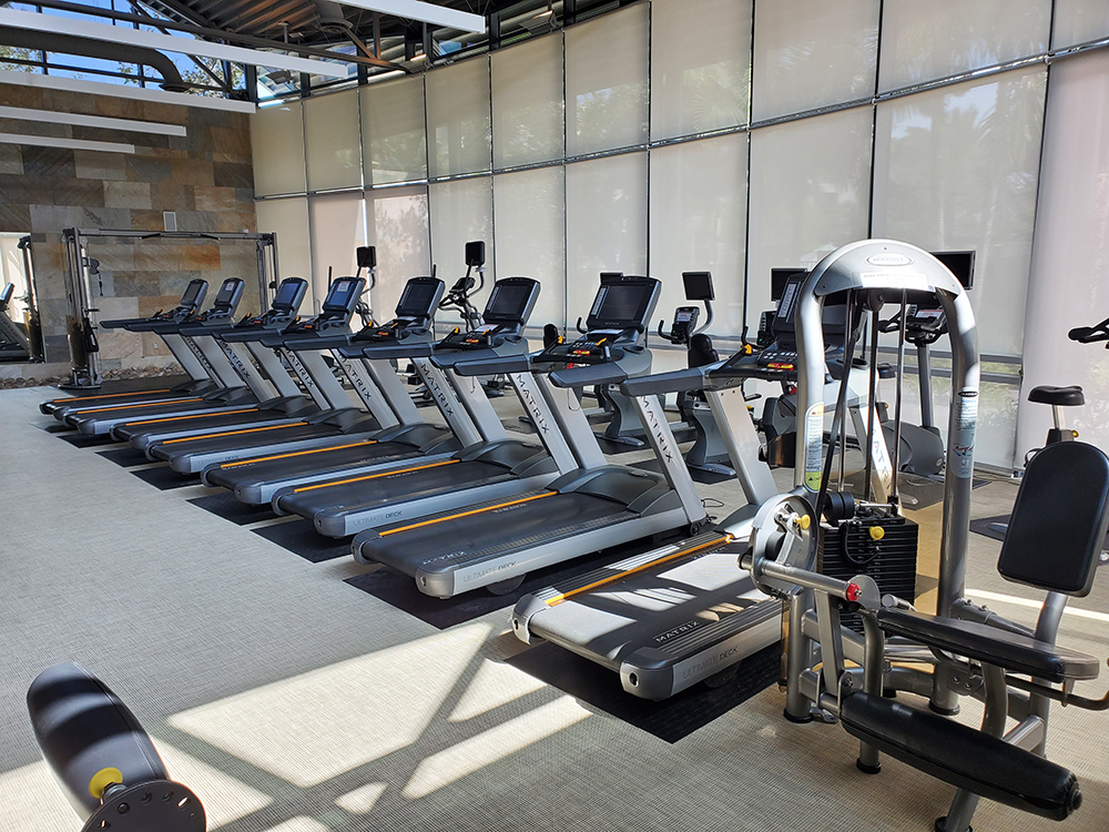 row of treadmills at a residential community's completed new gym