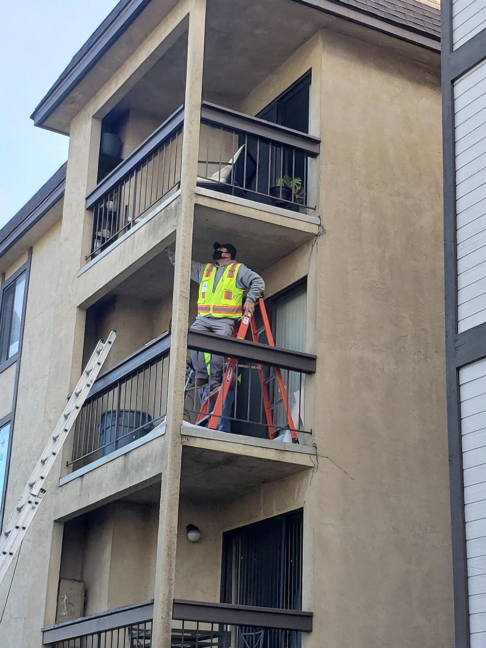 PIW inspector performing SB721 deck inspections at a California apartment complex