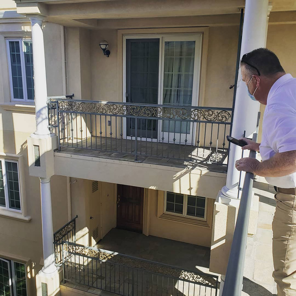 PIW inspector looking at balconies on a site walk for SB326 inspections