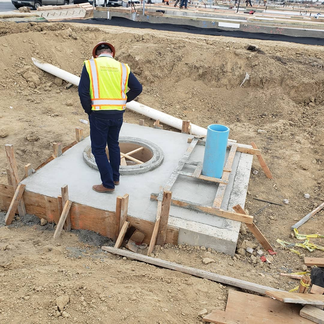 PIW inspector reviewing foundation installation at new construction jobsite