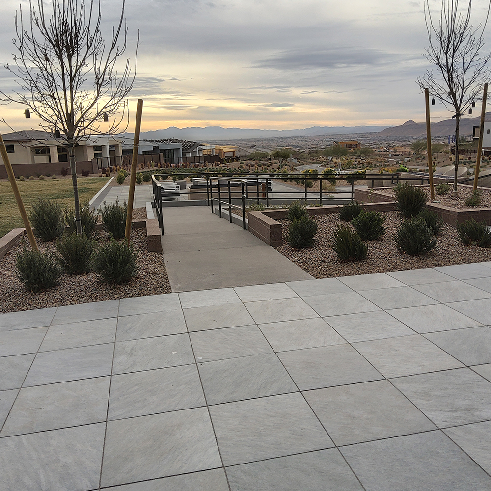 finished residential common area with landscaping and seating