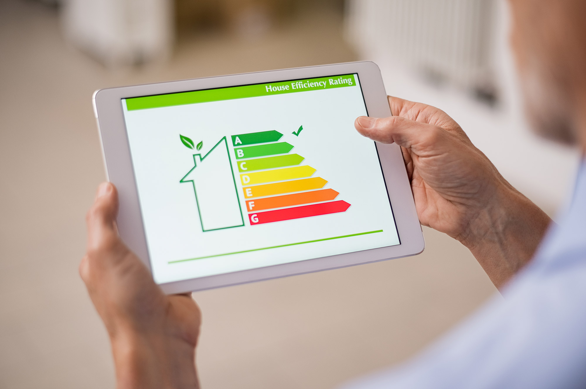 inspector holding tablet showing home energy rating system app