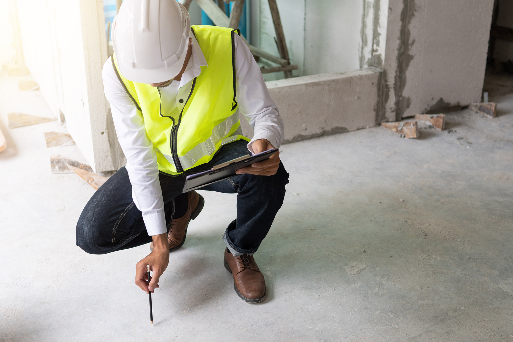 inspector reviewing installation of material at a construction site
