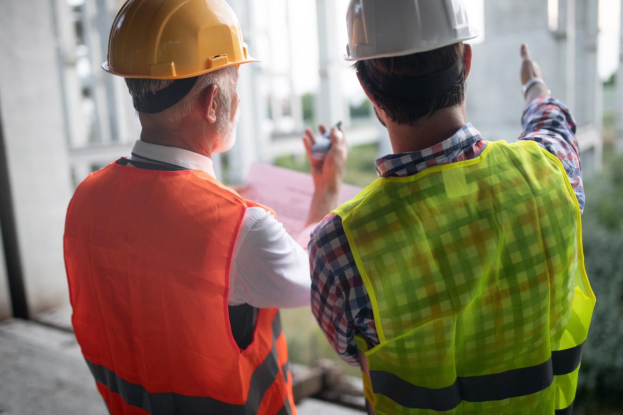 inspectors at jobsite reviewing construction processes