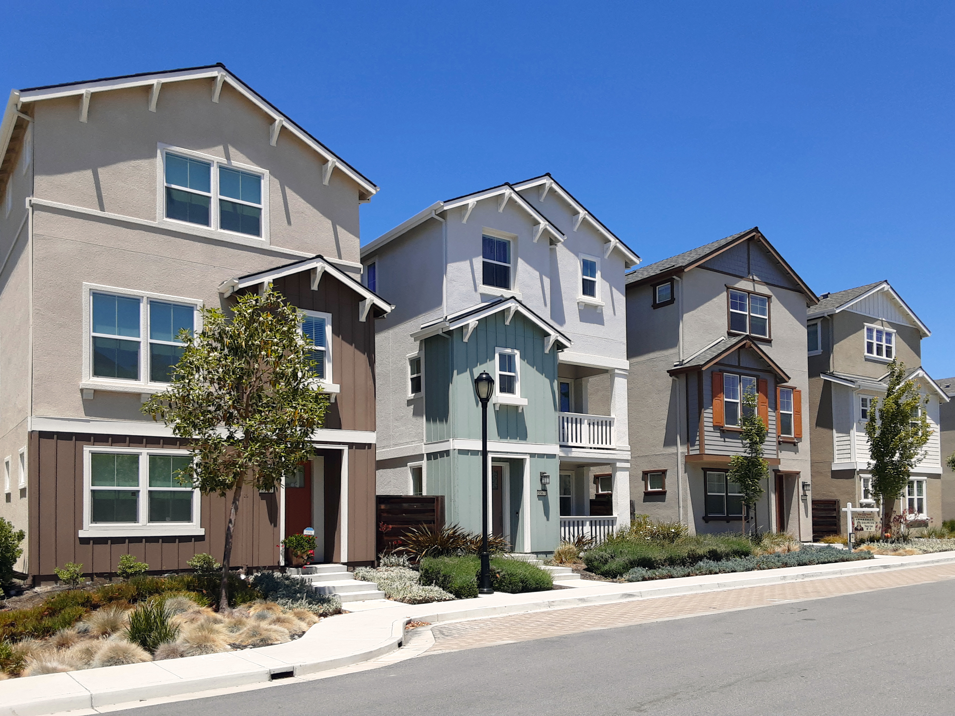 row of completed new construction residential buildings