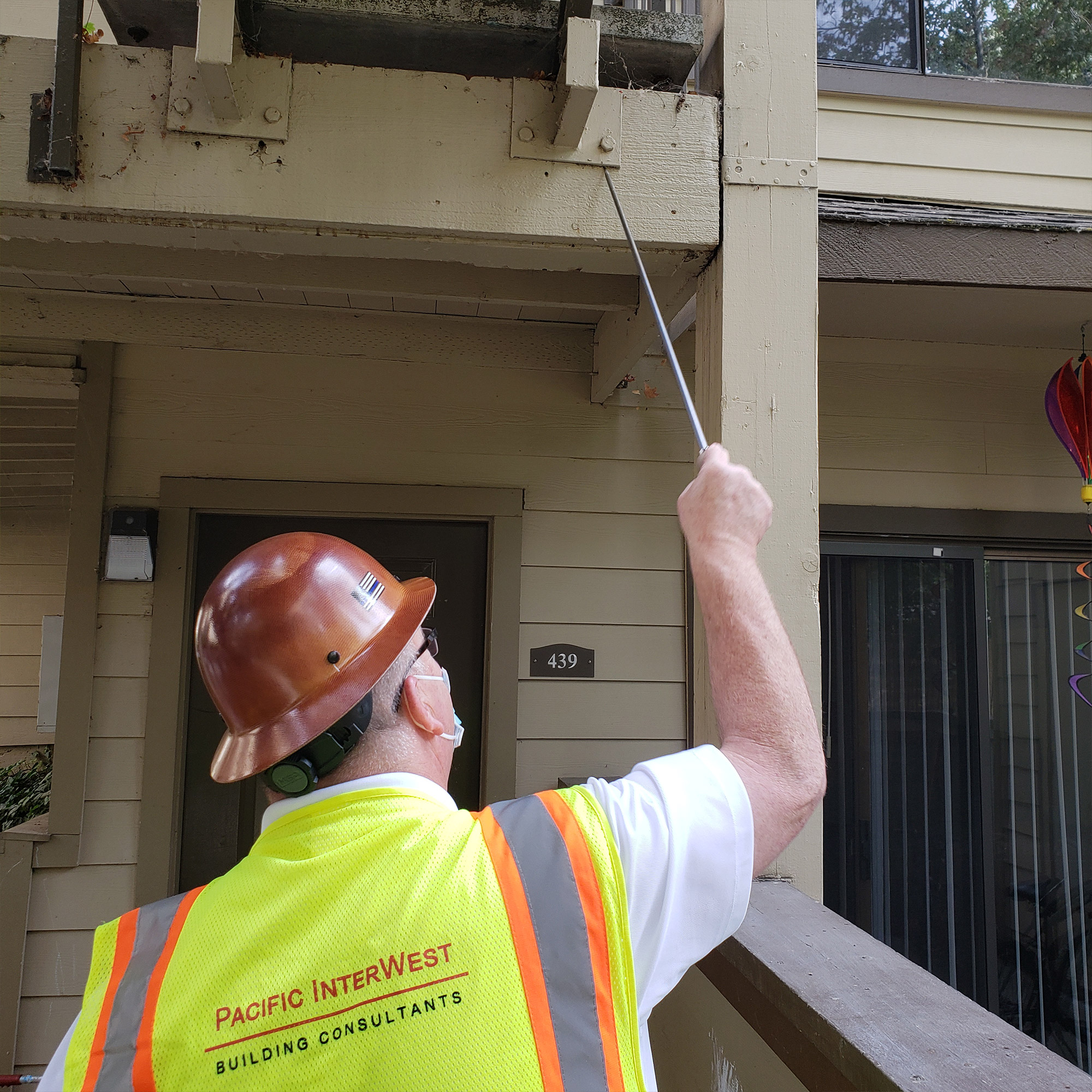 PIW inspecting balcony for SB721 compliance in CA